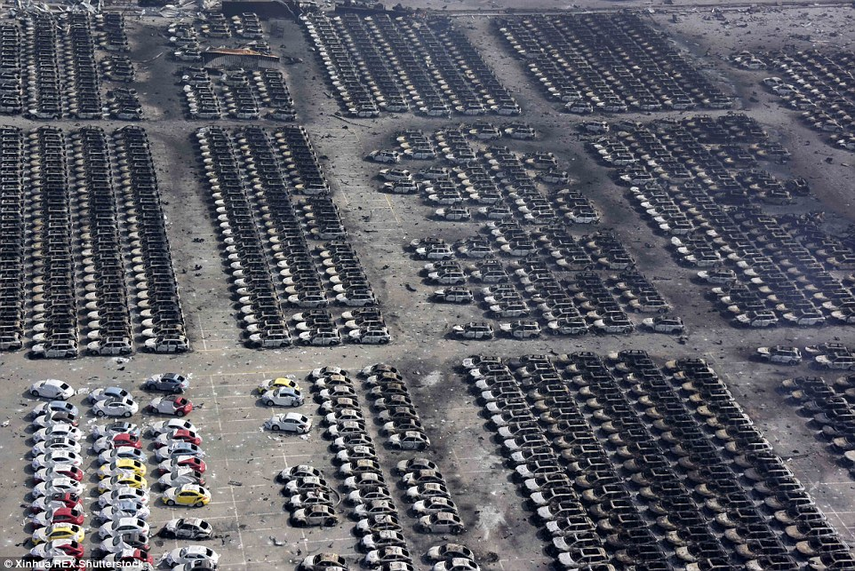 The blasts, originating from the Tianjin Dongjiang Port Ruihai International Logistics Co for hazardous material, turned buildings in the immediate vicinity into charred, skeletal shells and left hundreds of cars reduced to husks