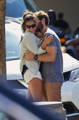Cheeky! The handsome 30-year-old actor looked smitten with his gorgeous girlfriend, who giggled as he nuzzled into her neck