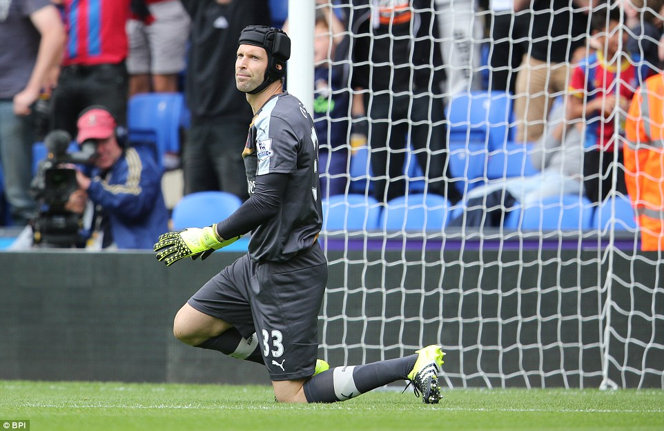 Arsenal goalkeeper Petr Cech looks dejected after conceding his third Premier League goal since completing his move to north London