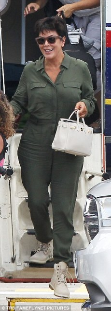 Matchy-matchy: Earlier on Monday Kourtney found herself wearing a matching olive green jumpsuit to her mother