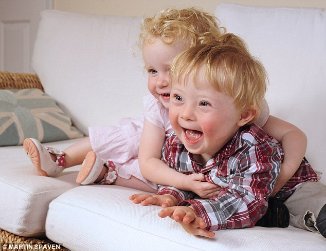 The McIntosh twins: Josh - who was born with Down's syndrome (right) and his sister Cara (left)