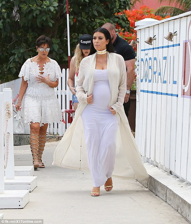 Leading the pack: Kim kept ahead of her family and bodyguard