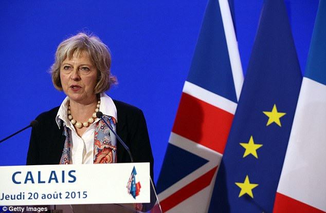 New measures: Home Secretary Theresa May signed an agreement with Bernard Cazeneuve, the French interior minister, to toughen up the measures to tackle the migrant crisis in Calais