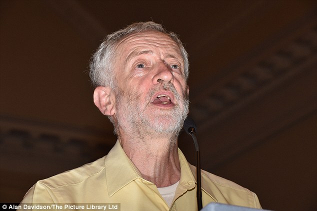 Corbyn, pictured at a rally in Nottingham today, likened US troops to IS in a previous interview on Russia today