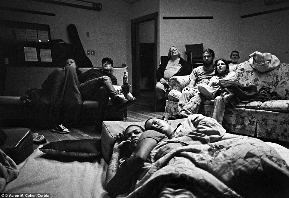 Unusual lifestyle: Eight members of Twin Oaks - a commune in rural Virginia with a population of only 105 - are pictured watching a DVD