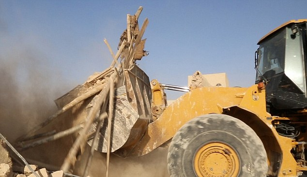 Inhumane: Images shared by Islamic State's Dishmaq media office in Syria showed the bulldozer ploughing into the ancient structure
