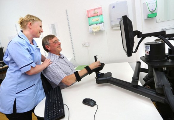 Patients taking part in trials of the method sit at a table facing a computer screen and place their arm on to a specially designed support