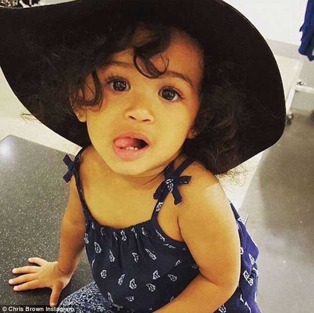 Daddy's little girl: The one-year-old child is Chris' baby with Nia Guzman, a woman with whom Chris had a fling