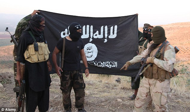 Poised to strike: Around 800 jihadists have returned to Europe to launch attacks after being trained by the Islamic State (above) or Al Qaeda-linked groups in Iraq and Syria, intelligence services have warned