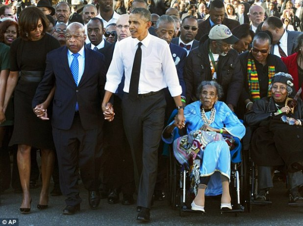 President Barack Obama holds hands with Rep. John Lewis, D-Ga., left, and Amelia Boynton Robinson, right, who were both beaten during Bloody Sunday (pictured in March, 2015)