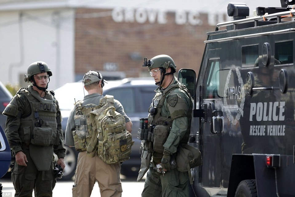 Armed men were seen around the Illinois town trying to hunt down three suspicious men