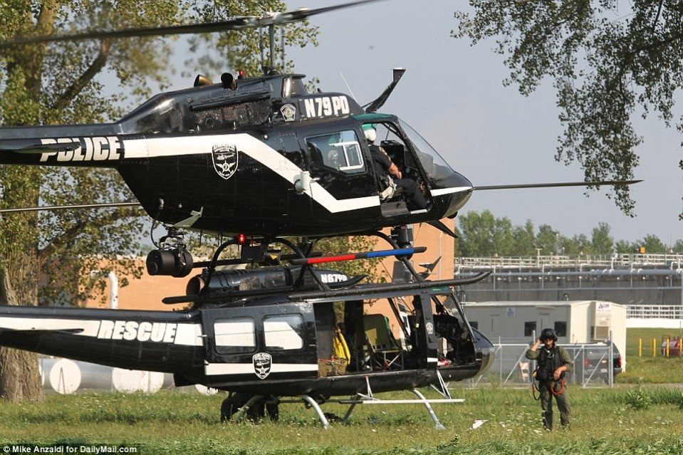 Two police helicopters were deployed in the search, launched after the officer was killed on his morning patrol