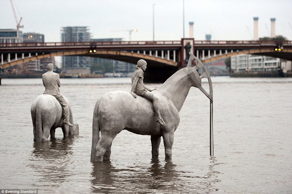 Standing tall: This picture of two of the horse sculptures shows what tourists will see from the riverbank when the Thames tide is low
