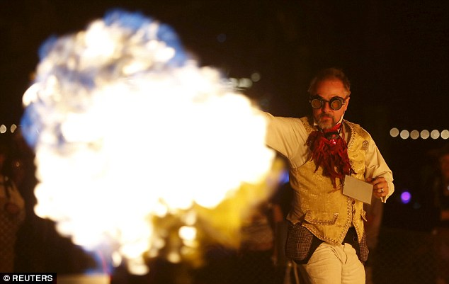 'Charcade'L Samuel Coniglio controls the flames by dancing at the Charcade during the Burning Man 2015 'Carnival of Mirrors'