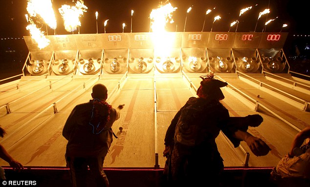 Skeeball of flames: People play a game of flaming skee-ball at the Charcade during the Burning Man 2015 on Tuesday