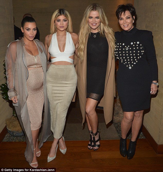Famouse family: Kim is shown with Kylie Jenner, Khloe Kardashian and Kris Jenner on Tuesday at an event promoting their new apps