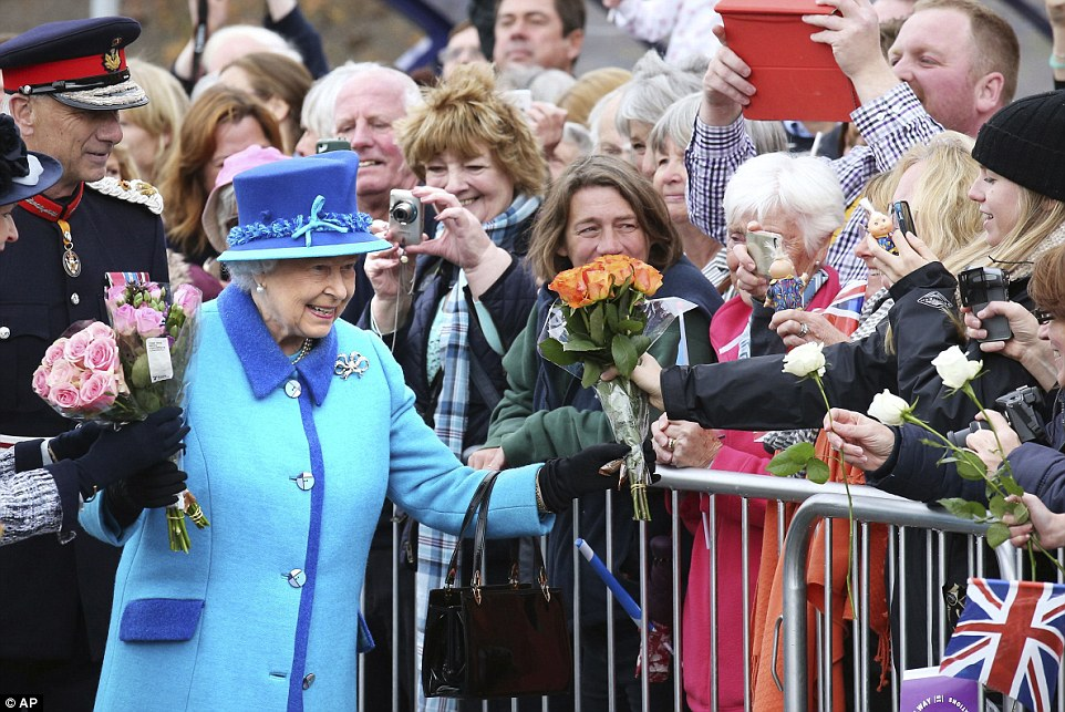 Touched: Speaking to the crowd at the station, the Queen, pictured in Tweedbank, thanked well-wishers for their messages of support