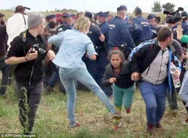 Vile: Petra Laszlo was caught on camera kicking a young refugee girl as she fled with other migrants from a police line during disturbances at Roszke