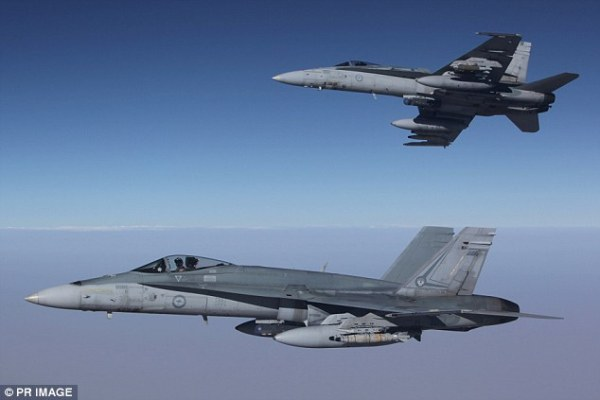 Australian fighter jets 'drop three bombs on ISIS targets ...