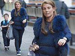 18 Sep 2015 - LONDON - UK  COLEEN ROONEY AND KAI ROONEY ARRIVE AT LONDON EUSTON STATION WITH KAI'S FRIEND. THEY HAD A LARGE SUITCASE WITH THEM.  BYLINE MUST READ : XPOSUREPHOTOS.COM  ***UK CLIENTS - PICTURES CONTAINING CHILDREN PLEASE PIXELATE FACE PRIOR TO PUBLICATION ***  **UK CLIENTS MUST CALL PRIOR TO TV OR ONLINE USAGE PLEASE TELEPHONE   44 208 344 2007 **