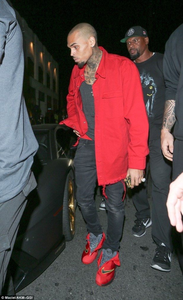 In the red: Chris Brown was given a ticket by a police officer on Friday after illegally parking his Lamborghini outside a club in Hollywood