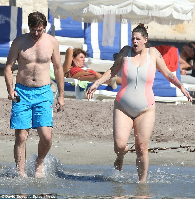 Diving in: Also taking part in the family festivities was Fifi, who stepped out in a pink and grey swimsuit