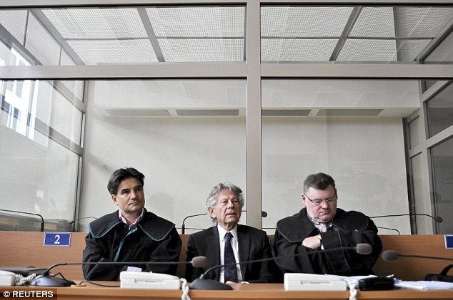 Filmmaker: Polanski - sitting with his legal team in court today -hopes to make a movie in his homeland - something that would be jeopardised if the extradition request is granted