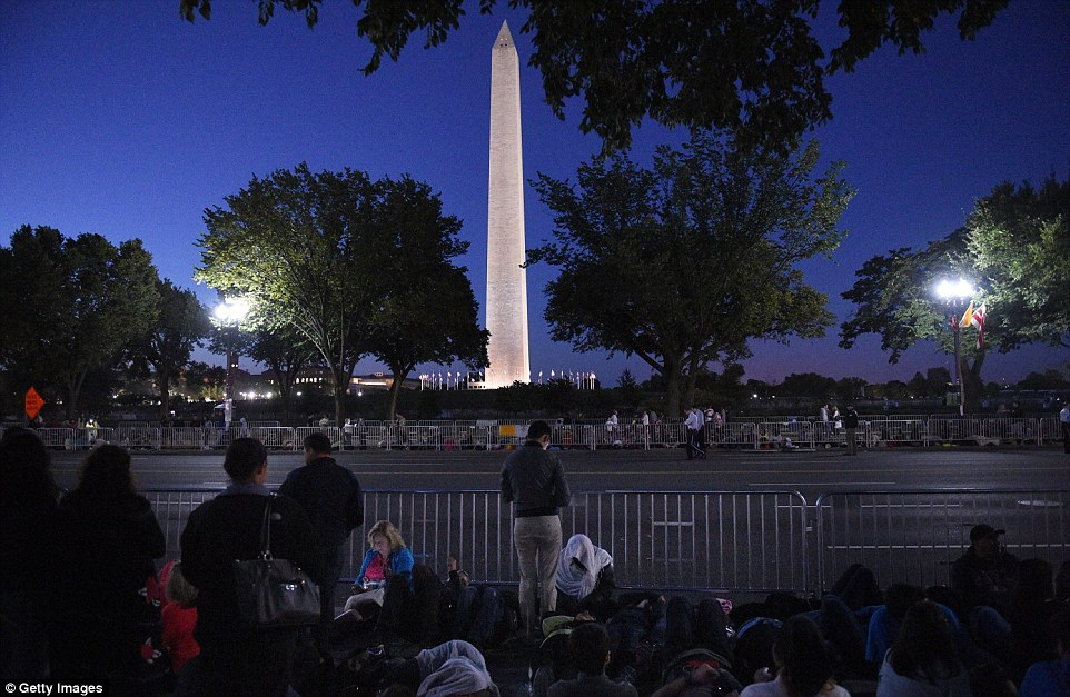 Spectators were gathered as early as 5am along the parade route south of the White House on Wednesday to catch a glimpse of the pope