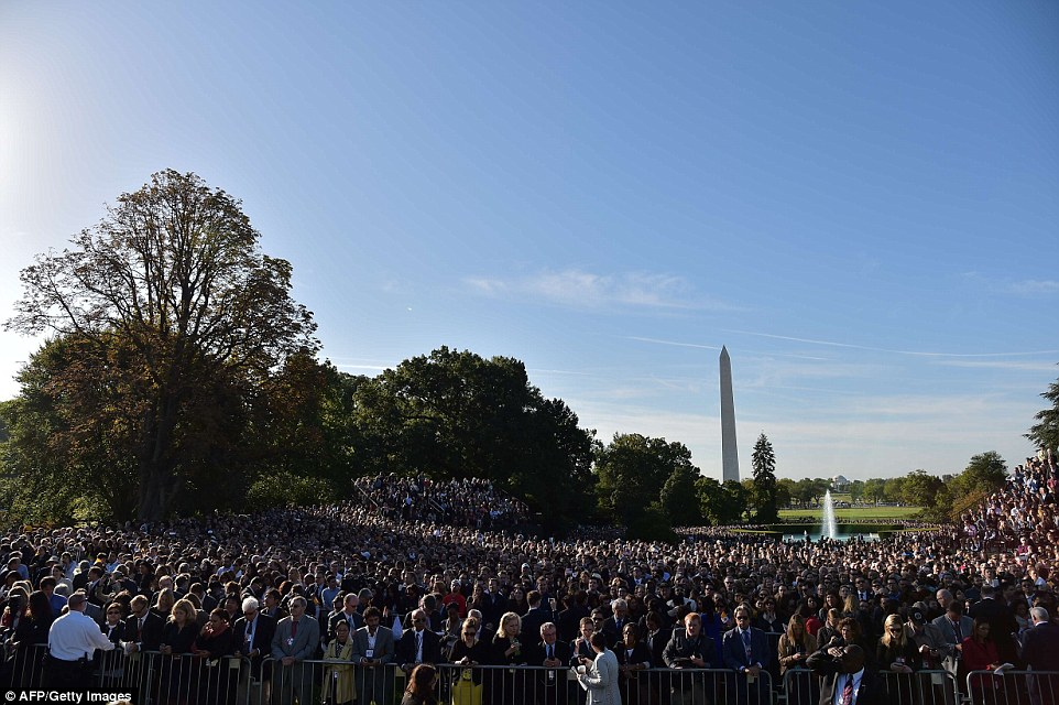 People wait for the arrival of Pope Francis at the White House on September 23, 2015 in Washington,DC. President Barack Obama will host Pope Francis at the White House for the first time Wednesday, warmly embracing the Catholic pontiff seen as both a moral authority and potent political ally