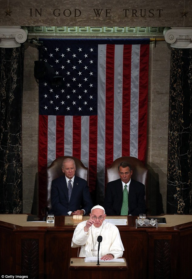 Francis' speech in the House chamber came under the phrase 'In God We Trust,' carved atop the wall behind the speaker's podium