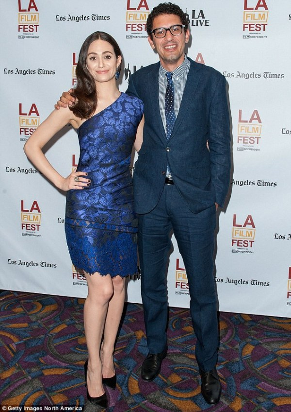 Emmy Rossum flashes her bra in see-through top as she ...