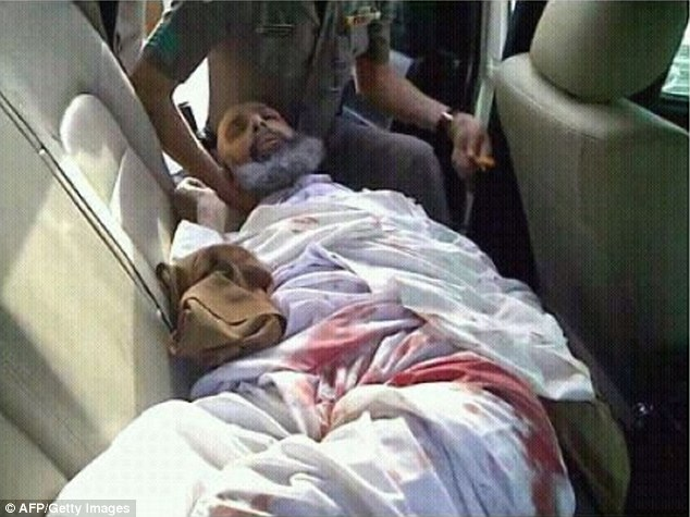 Activist: The source believes the government is taking revenge on Ali because his uncle Sheikh Nimr al-Nimr (pictured wounded in the back of a police car after his arrest in 2012) who spoke out against them