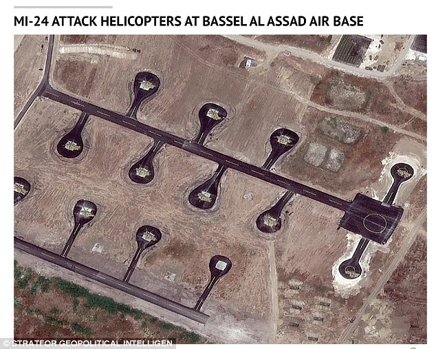Russian MI-24 attack helicopters at Bassel Al Assad Air Base: Russia has forges ahead with its military build-up in Syria that now includes dozens of advanced fighter jets as well as tanks, troops and artillery