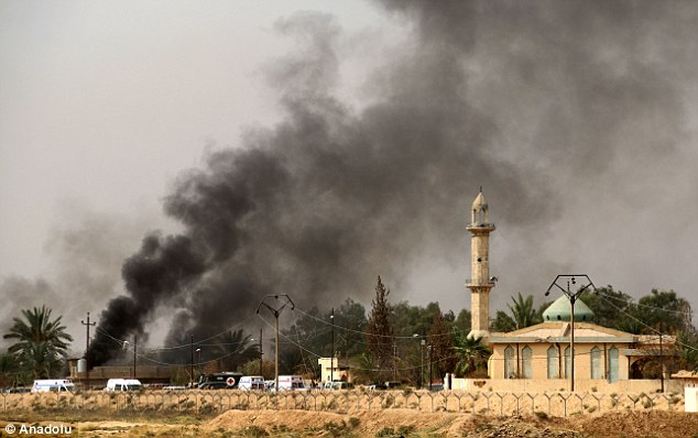 Smoke rises during a military operation launched by Kurdish troops, known as peshmerga, to regain control of some villages from Islamic State west of the oil-rich city of Kirkuk, which is 180 milesnorth of Baghdad, Iraq