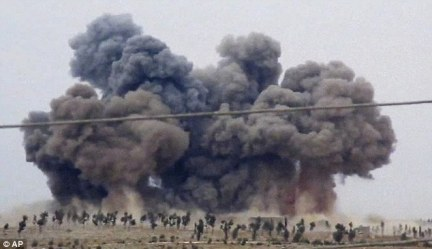 Bombing campaign: Vladimir Putin has conscripted 150,000 new troops into the Russian army as the country unleashed a new wave of airstrikes in Syria, including rebel positions in Idlib pictured)