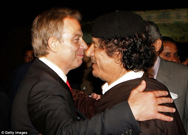 Here the pair are pictured embracing after a meeting in Sirte, Libya, in 2007