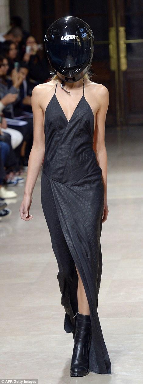 A model showcases a strappy v-neck grey slip dress with a snakeskin print