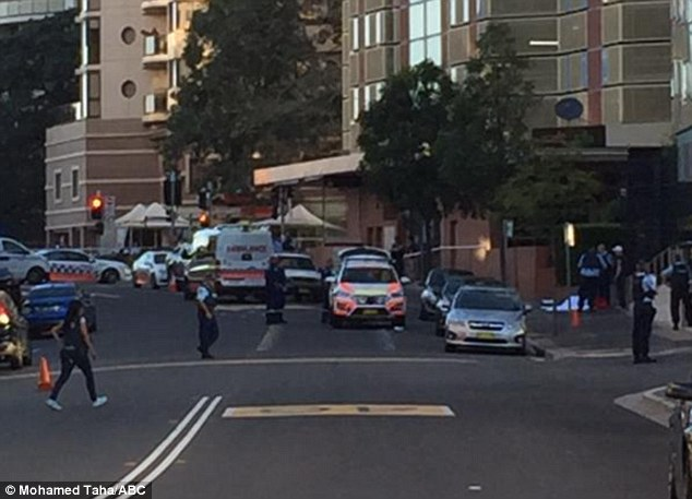 Witnesses have described seeing the gunman, who was dressed all in black, running down the street brandishing a pistol at 4.30pm today just before he was shot, pictured is the scene outside the station