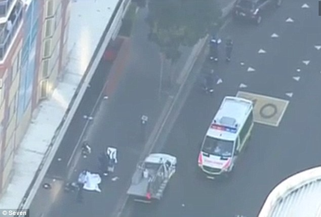 Witnesses have reported seeing two bodies lying on the ground covered in white sheets (pictured)