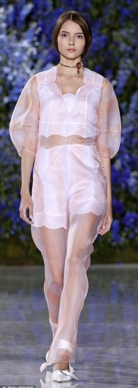 Oh so pretty: Scalloped hems on pristine white separates were layered under delicate sheer pinks and cosy knits on Dior's Spring runway