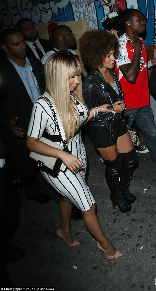 Trouble at the start:Meek claims he courted Nicki for a year but only after she split with ex Safaree Samuels did she finally reach out to him - problem was he was headed to jail for violating his parole