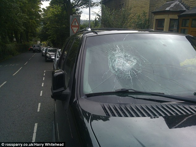 Violence: Over the last year, Mr Hussain has had his car windscreen (pictured) smashed six times at a cost of £5,000