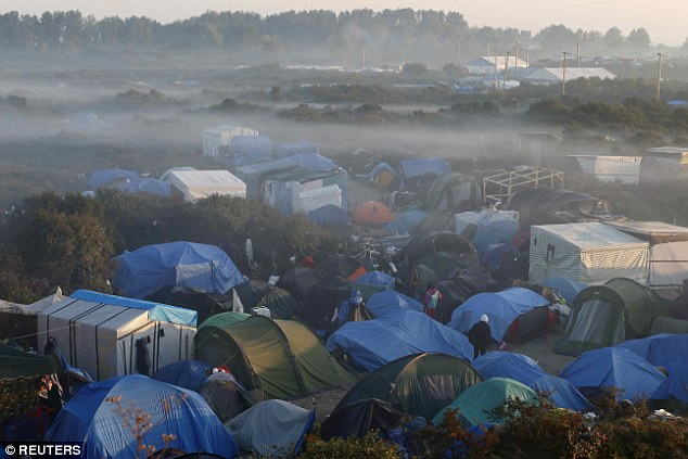 Migrant crisis: Pictured are tents shrouded by fog in the 'new jungle' of a huge migrant camp in Calais