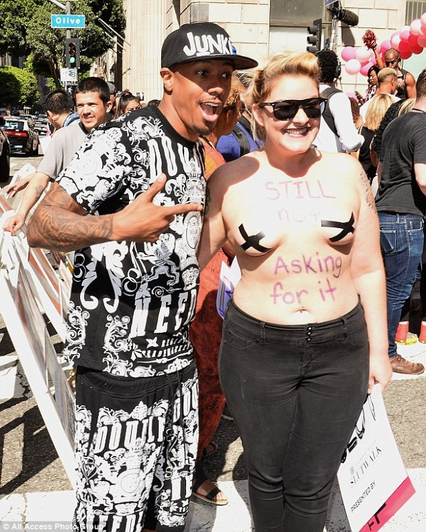 Like what you see? Nick Cannon posed with a woman with tape on her boobs