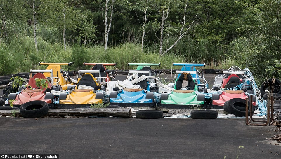 Go karts remain lined up and ready to race in an entertainment park located within the 12.5mile exclusion zone