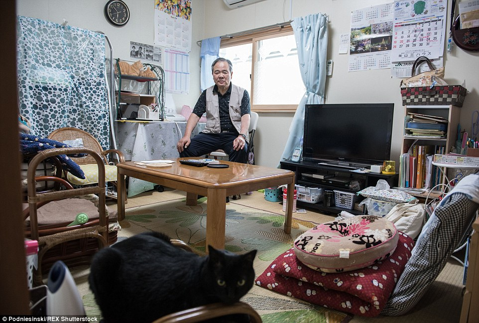 Kouichi Nozawa (pictured) lives with his wife Youko in a room in temporary housing near Fukushima, after being evacuated out of the exclusion zone