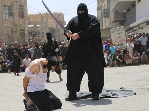Obese executioner: The 30-stone jihadi has become infamous as one of ISIS's most feared executioners but his identity has never been revealed