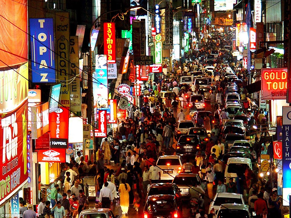 Commuters are seen making their way through the packed commercial street in the southern Indian city of Bangalore