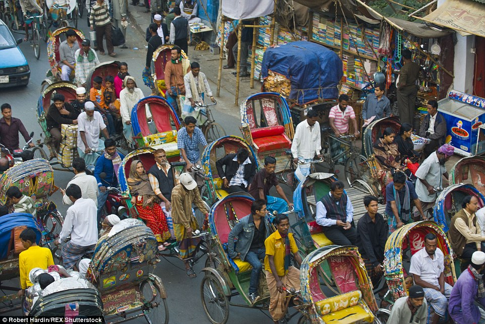 The easiest way to travel? This busy road in Dhaka, Bangladesh, is packed with colourful rickshaws during peak times