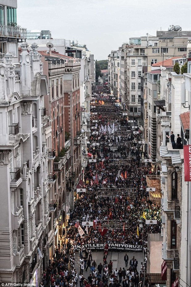 Rally: Thousands of protesters take part in a demonstration against the deadly Turkish attacks, in Istanbul today